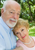Devoted Senior Couple. Portrait of a loving, devoted senior couple outdoors Royalty Free Stock Photo