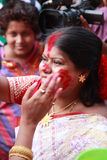 Devotee apply sindhoor during Durga Puja festival Stock Photo