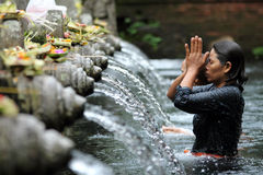 Ritual Bathing at Puru Tirtha Empul, Bali. Devotee going through a Hindu ritual bathing at a religious bathing pool located within the Puru Tirtha Empul Temple royalty free stock photography