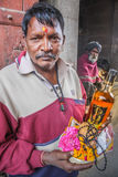 Devotee offering liquor. Kaal Bhairav temple has unique tradition of offering liquor to God Bhairava. This place of Rjjain/India is world famous. A devotee Stock Photos