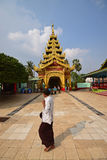 A devotee passing by looking at the house of worship in Shwemawdaw Pagoda at Bago, Myanmar Royalty Free Stock Photos