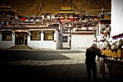 A devotee with prayer wheels at Tashilompu Monastery Shigaste Ti Stock Photography