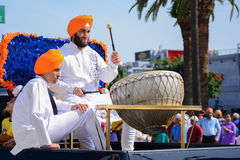 Devotee Sikh beating a drum. Stock Image