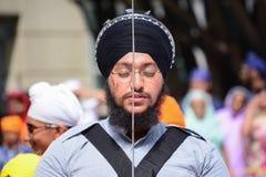 Devotee Sikh with black turban recite prayer Stock Photo