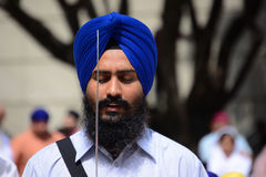 Devotee Sikh with blue turban recite prayer. Stock Images