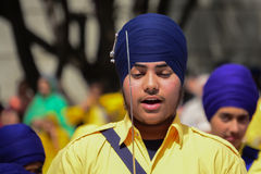 Devotee Sikh with blue turban recite prayer. Royalty Free Stock Photos