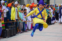 Devotee Sikh dancing. Los Angeles, CA - Abril 5, 2015: Devotee Sikh dancing at the Anniversary of Baisakhi celebration Stock Image