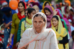 Devotee Sikh woman marching Stock Photo