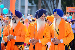 Devotee Sikhs with blue turbans holding swords Stock Photos