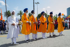 Devotee Sikhs with blue turbans holding swords Royalty Free Stock Image