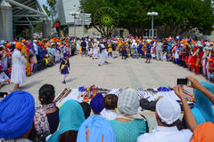 Devotee Sikhs dancing. Los Angeles, CA - Abril 5, 2015: Devotee Sikhs dancing at the Anniversary of Baisakhi celebration Stock Photos