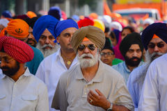 Devotee Sikhs men with  turbans marching Stock Photos