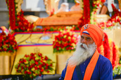 Devotee Sikhs with orange turban marching Stock Photography