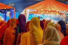 Devotee Sikhs praying. Los Angeles, CA - Abril 5, 2015: Devotee Sikhs praying  at the Anniversary of Baisakhi celebration Stock Image