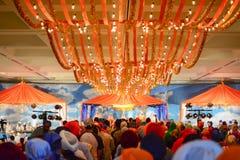 Devotee Sikhs recite prayers. Los Angeles, CA - Abril 5, 2015: Devotee Sikhs recite prayers at the Anniversary of Baisakhi celebration Stock Image