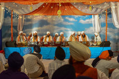 Devotee Sikhs recite prayers Royalty Free Stock Photo