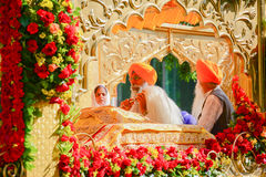 Devotee Sikhs recite prayers Royalty Free Stock Photos