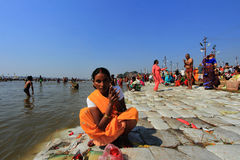 A devotee takes bath in the river during the Kumbh Mela Royalty Free Stock Images