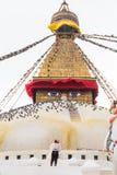 Devotee worshiping the sacred Boudhanath Stupa in Kathmandu, Nep. Al Stock Image