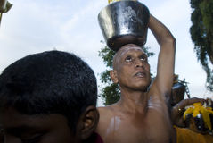 Devotees carrying milk pot Stock Photos