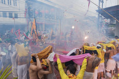 Devotees of a Chinese Taoist shrine carry a palanquin housing a Stock Images