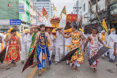 Devotees of a Chinese Taoist shrine carry a palanquin housing a Royalty Free Stock Images