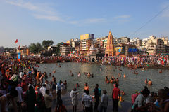 Devotees come to bath in the river at Kumbh Mela Royalty Free Stock Photography