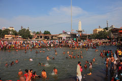 Devotees come to bath in the river at Kumbh Mela Royalty Free Stock Image