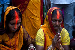 Devotees. Female devotees performing rituals during Chhath puja In India. It is the festival which is dedicated to the Sun god Stock Photography