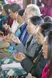 Devotees hold prayer beads and rice during an Amitabha Empowerment Buddhist Ceremony, Meditation Mount in Ojai, CA Stock Image