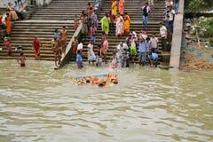 Devotees immerse idols at Durga Puja in Kolkata Royalty Free Stock Photos