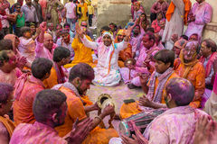 Devotees play music covered with colors during the Holi celebration in Barsana, India Stock Images