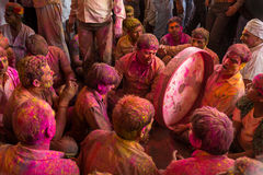 Devotees play music covered with colors during the Holi celebration in Barsana, India Stock Photos