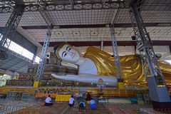 Devotees praying at Shwethalyaung Buddha, Bago, Myanmar Stock Photos