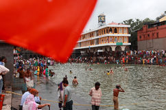 Devotees take bath in the river Godavari Royalty Free Stock Photography