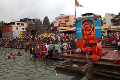 Devotees take bath in the river Godavari Stock Photos