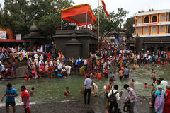 Devotees take bath in the river Godavari Royalty Free Stock Photos