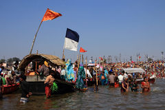 Devotees take holy bath during the Kumbh Mela Stock Photography