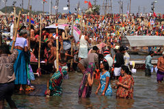 Devotees take holy bath during the Kumbh Mela Royalty Free Stock Images