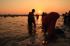 Devotees taking holy dip in the river Ganges during the Kumbh Mela Stock Photography