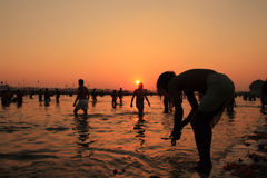 Devotees taking holy dip in the river Ganges during the Kumbh Mela Royalty Free Stock Photo