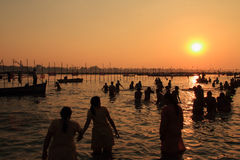 Devotees taking holy dip in the river Ganges during the Kumbh Mela Royalty Free Stock Images
