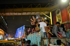 Devotees transport an idol at Durga Puja to Stock Photography