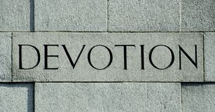 Devotion. A granite carving on a monument outside of Trafalgar square, London, UK royalty free stock image