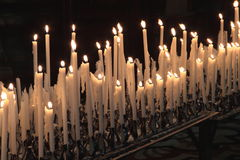 Devotion candles. Many lit candles of devotion stock images
