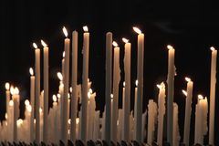 Devotion candles. Many lit candles of devotion stock photography