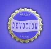 Devotion Themed Bottlecap. A photo of a devotion themed bottle cap Stock Photo