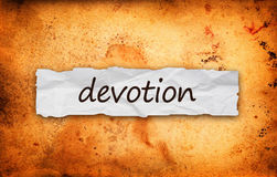 Devotion title on piece of paper. Devotion title on piece of crumpled old paper royalty free stock photos