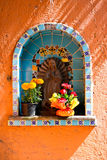 Devotion to the Virgin Mary. Found at the entrance of a house, guarded by flowers Royalty Free Stock Photos