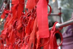 India temple bangle with red cloth. Devotional red cloth with bangle use for wish at temple in India royalty free stock images